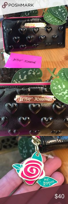 "New Betsey Johnson Patent Leather Wallet NWT. Black patent leather with raised hearts wallet by Betsey Johnson. Large sized, 8""x4 1/2"" with multiple card holders, zippered coin purse and clear ID holder. Zipper pull is a painted metal flower with Betsey's signature. Interior is gold and black silky material. Betsey Johnson Bags Wallets"