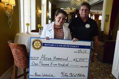 Alexa Hammond receiving a scholarship for the nurses program through NCMC.