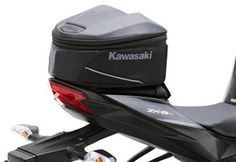 "Kawasaki Soft Top Trunk Case Ninja 300 ZX6R ZX10R Black 8 Liters. Part Number: K57003-105A. Reflective piping for night visibility. Molded Kawasaki logo on lid. Official Kawasaki Product. Model Fit: Ninja 300 13-14, ZX6R 09-14, ZX10R 11-14. Rugged, water-resistant nylon construction with reinforced foam body and lid Mounts to rear seat easily with hook-and-loop straps that are removable only by key release of seat Expandable feature adds 3"" of vertical storage capacity .6-8 liters."