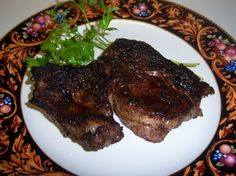We discovered the Chuck Eye steaks a few years back at our local grocery store. The butcher recommended them to us. He calls them the poor mans rib eye. They come out incredibly tender; you just cant beat them for the price. We prepare them many different ways, but this is my husband's favorite when hes in the mood for a spiced up steak. I highly suggest preparing them outdoors on a grill side burner if you have one, as the rub does smoke when cooked in the cast iron pan.