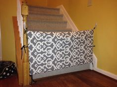 fabric gate for when Norah starts getting around. Maybe something stronger than those ties to secure it.