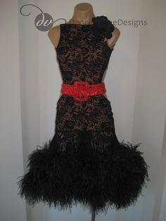 Black lacy latin dress with feathers and a red belt from Vogue Designs. Visit http://ballroomguide.com/comp/attire/lady.html for more info about competition attire.
