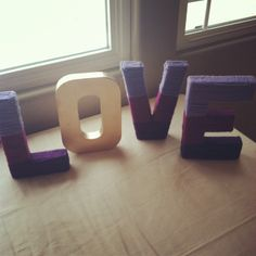 Love sign.. Purple and gold bridal shower