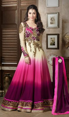 Shraddha Kapoor Georgette Long Length Anarkali Suit Showcase a blend of traditional and modern style as Shraddha Kapoor with this cream, pink and purple shaded faux georgette long length Anarkali suit. Kameez features embroidered and crystal embellished floral patterned yoke patch and hemline patch that spruces its overall look. #DesignerPartyWearAnarkaliSuits #BollywoodSuitsOnlineIndia