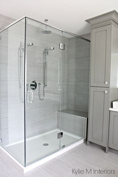 Walk in shower with 2 shower heads, fibreglass base and porcelain surround. Vanity tower painted Benjamin Moore Chelsea Gray. Design by Kylie M Interiors E-Design