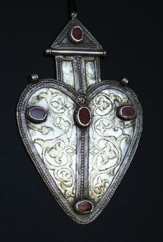 """A silver heart-shapoed """"asyk."""" Posted by Thelma"""