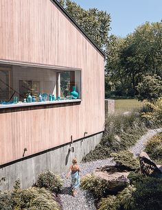 New Yorkers Catherine Greenman and Richard D'Albert spend weekends with their four children at the house, which is clad in Atlantic white cedar boards.
