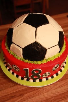 """Birthday cake for a 13-year-old girl who loves soccer, whose number is 18, and whose team colors are red and black! Vanilla cake with vanilla buttercream, gumpaste decoration, and hand-painted soccer ball """"polka dots."""""""