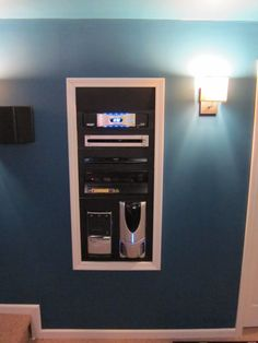 In the home theater near the screen is a setup like this for playing movies in multiple formats. Though there is a door that can be closed to hide it away. There is a second one that holds multiple gaming systems which were either purchased for ghouls and guests or left behind from when Sam was living with her.