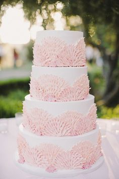 Gorgeous Beach Themed Seashell Wedding Cake - this seashell cake looks pretty in pink but would also look fab in aqua or coral for a beach themed wedding.