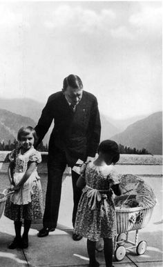 There are literally tons of Berghof terrace photos but I have never seen this one. Hitler with a baby carriage! Looks like 1935.
