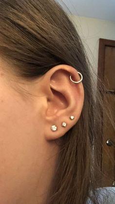 Ear Piercing For Women Cute And Beautiful Ideas Ear Piercing Ideas Unique. Unique Ear rings and ear piercing ideas. Unique Ear rings and ear piercing ideas. Innenohr Piercing, 3 Ear Piercings, Tattoo Und Piercing, Triple Lobe Piercing, Helix Piercing Jewelry, Multiple Ear Piercings, Helix Ring, Face Peircings, Upper Ear Piercing