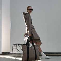 Rains focuses on comfortable, versatile silhouettes designed to suit any lifestyle, and this 'Trendsetter' Long Taupe Curve Coat is the perfect example 😎 #jessimara Woman Silhouette, Silhouette Design, Taupe, Duster Coat, Rain Jacket, Normcore, Female