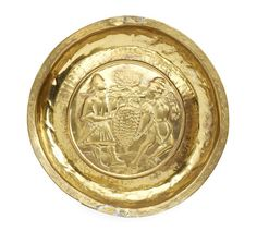 An early 16th century brass narrow-rimmed alms dish, Nuremberg, The Spies or Thieves from Canaan