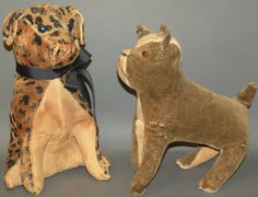 "Two straw stuffed dogs- ca. 1900; sitting spotted dog with button eyes, 13""; felt cloth bulldog with celluloid eyes, 12""."