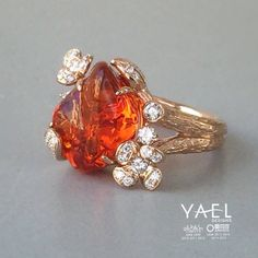 What shall we call our latest fire opal and diamond ring?