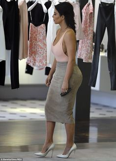 Shop 'til you drop! Despite having been accompanied by sufficient luggage to clothe an entire family as she jetted to Paris from her native Los Angeles, Kim Kardashian seemed intent on splashing the cash - and was spotted trawling through the clothes on offer