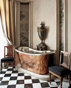The Gilded Age-A pair of mahogany Jacob chairs flanks a copper tub in a bathroom with grisaille and black and white tiles ~ by designer Frederic Mechiche - 3.16.2013