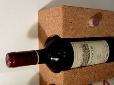 Wine Rack (Deger Cengiz, 2010): a wine rack made of waste material from wine cork industry. The design of the rack allows the bottle labels exposed, so there is no need to pull the bottles out to see the labels. The wine stoppers on the front face hide the mounting screws.