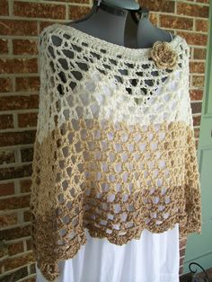 Plus Size ladies crochet poncho, cover up, shoulder wrap, shawl in open V-stitch pattern, with feminine scalloped edging. Bonus detachable crocheted Flower Pin (3.5 diameter) included, to wear on poncho, or elsewhere as a brooch. A versatile layering piece that can be worn as a V neck, or turn slightly sideways for dramatic look, or turn fully sideways for boatneck look. Lovely drape and flattering for all figure types. Shown on size 14 dress form. Measures 31 long from center neck V to…
