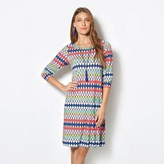Casual White Ellen Dress  Revamp your spring wardrobe with pops of color and this knit dress in a vibrant geometric print.  Reg. $29.99