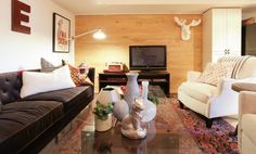 Wood paneled wall in basement living room #IncomeProperty #HGTV