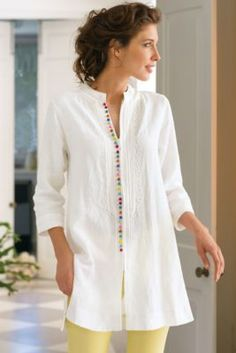 Globetrotting tunic in easy, lightweight linen is richly detailed with a row of colorful French knots along the hidden-zipper closure, plus swirly soutache trim. A stand colla