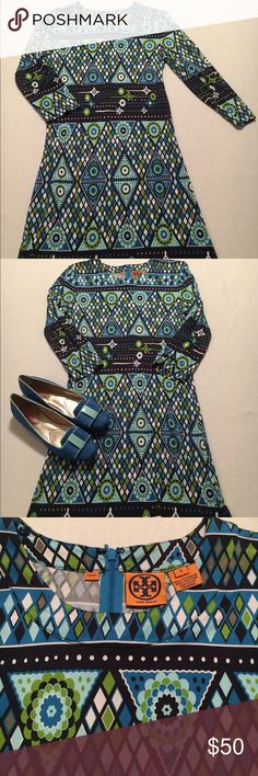 "Tory Burch Silk Dress EUC like new Tory Burch 100% silk dress. Size 8.  Could fit a size 6 also.  Vivid, beautiful Tory design with green, turquoise and dark navy blue.  Fabric feels wonderfully soft and has lots of stretch! Perfect condition. Zips up back.  Shown with Issac Mizrahi blue/green loafers and cAbi green jacket both sold separately in my closet. Versatile to dress up or throw on sandals for daytime coastal look.  Length 37"", Bust 17"" flat, Waist 16"" and 19"" 3/4 length sleeves…"
