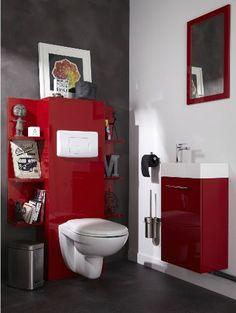 Des WC pleins de caractère grâce à des meubles rouge vif laqués qui s'accordent parfaitement avec le gris bétonné du mur et du sol.