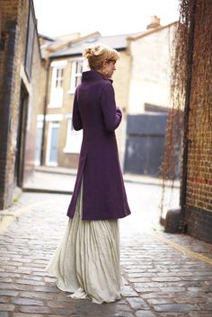 This casual coat meshes surprisingly well with this evening gown...