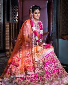 Bride @MiloniChoksi's bright pink and orange lehenga by Anamika Khanna with gold floral 3D embroidery is the prettiest thing you'll come across today. Makup Artist- @recinda_martis (Mumbai) Photo Courtesy- @storiesbyjosephradhik (Mumbai)