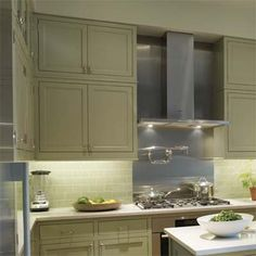 In a small kitchen, double-height cabinets maximize storage and draw the eye upward, taking attention away from the limited counter space underneath. | Photo: Wendell T. Webber | thisoldhouse.com