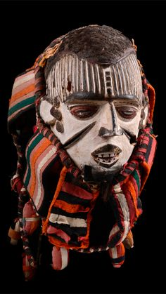 Africa | Anthropomorphic face mask from the Igbo people of Nigeria | Wood, akoline, black and red paint, coiffure of real hair and face framed with pieces of fabric