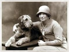 I've always liked this photo of a much loved Airedale carefully included in this fashionably dressed lady's portrait.