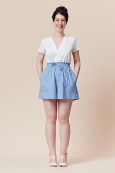 High-waisted elasticated shorts and skirt, with drawstring and patch pockets. Version A has a paperbag waist, version B has a simple waistband. The pattern envelope contains a full size pattern and a detailed instruction booklet. The PDF pattern contains a full size printable pattern (A0 and A4/US letter formats) and a detailed instruction file.