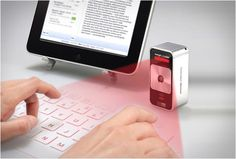 celluon-magic-cube  projects a keyboard on....anything.