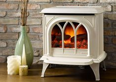 This electric stove comes equipped with premium decorative coals which serve as an alternative to often unrealistic logs. The all season stove needs only electric Read Electric Log Burner, Electric Logs, Electric Stove, Vive Le Vent, Stove Heater, Gas Stove, Stove Fireplace, Fireplace Accessories, Wood Burner