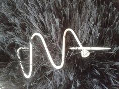 Shawl Pin - Repurposed Knitting Needle. $7.50, via Etsy.  (Now, where did I put my hammer?)