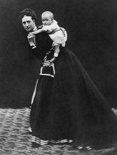 Queen Alexandra carrying the future George V
