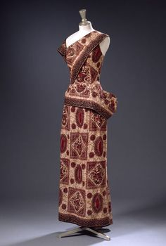 West African Object: Evening dress Place of origin: London, England (made) Manchester, England (fabric, made) Date: 1948 Artist/Maker: Matilda Etches (designer) Materials and Techniques: Printed cotton Museum number: T.186-1969 | V&A