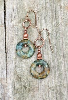 "Copper earrings with hand drawn, etched design. Approx 2"" in length and very light weight."