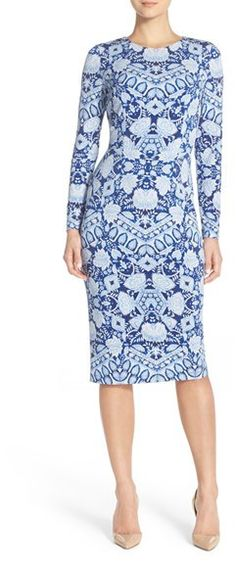 "Maggy London Print Jersey Midi Dress. Mesmerizing kaleidoscope prints refresh a stretchy jersey dress that hugs and flatters your curves from its high rounded neck to its midi-length hem. 42 1/2"" length (size 8). Back zip closure. Jewel neck. Long sleeves. Midweight, stretchy jersey. Fully lined. 95% polyester, 5% spandex. Machine wash cold, tumble dry low. By Maggy London; imported. Dresses."