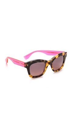 Solid arms play against the patterned frames on these thick Fendi sunglasses. Fendi, Cheap Ray Ban Sunglasses, Sunglasses Store, Eye Glasses, Glasses Style, Pink Eyes, Sunglass Frames, Handbag Accessories, Brown And Grey