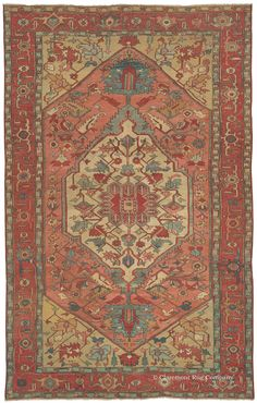 The colors in this enchanting 150 year old Persian Serapi carpet seem to float in place, quietly shimmering with patina. Its distinctive palette filling a soft watermelon field, delicate golden wheat corner pieces, and spaciously placed celadon, aquamarine, and sky blue stylized blossoms is very hard to find in antique oriental carpets. Gentle waves of abrash (intentional color striation) undulate throughout, adding tremendous movement and depth along its unusually elongated dimensions.