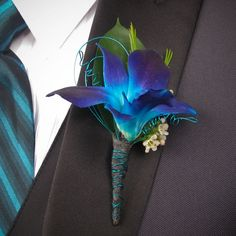 blue dendrobium orchid boutonniere for prom