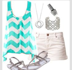 a  squiggly teal top with white shorts and a sparkly bracelet                          CUTE!!!!!