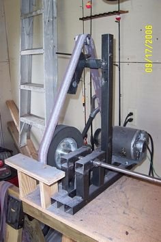 Belt Sander by Min -- Homemade belt sander constructed from square tubing, steel, aluminum, Delrin, and bronze. Powered by a surplus 1720 RPM treadmill motor. http://www.homemadetools.net/homemade-belt-sander-51