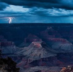 Stunning photo by Pete McBride! A heavy storm creates a powerful light show on the north rim of the Gramd Canyon