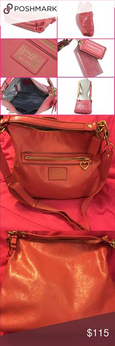 Coach Poppy Daisy liquid gloss bag 20108 Rare Authentic Coach Poppy Daisy Pink Liquid Gloss Patent Leather Hobo 20108 Rare.  Convertible and removable strap from shoulder to cross body. Zip top to close. Strap to carry on wrist. Pretty silky lining with leather Coach creed. Pockets for accessories. One zip pocket. Excellent condition. Smoke free home. Thanks for the interest and God Bless Coach Bags Crossbody Bags
