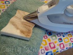 Clean your iron with a Mr. Clean Magic Eraser....just did this...it works!